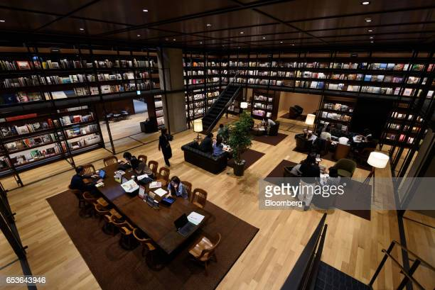 Employees work inside the reading room of Fast Retailing Co's Uniqlo City Tokyo office in Tokyo Japan on Friday March 10 2017 Uniqlo owner Fast...
