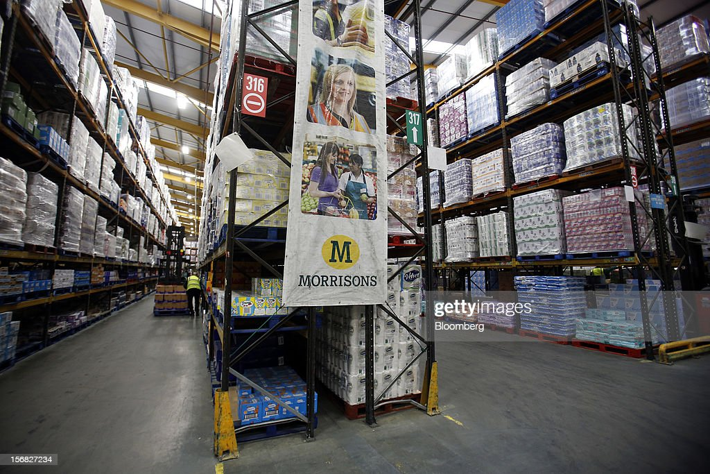Employees work inside WM Morrison Supermarkets Plc's distribution center in Wakefield, U.K., on Thursday, Nov. 22, 2012. Britain's economy will return to growth next year after stagnating in 2012, with expansion weighted in the second half, according to Bank of England projections published yesterday. Photographer: Simon Dawson/Bloomberg via Getty Images