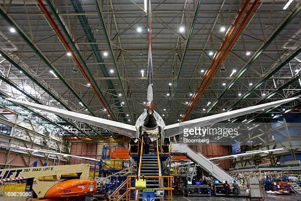 Employees work on a Boeing 787 Dreamliner during final assembly of the airplane at the Boeing Co factory in Everett Washington US on Tuesday May 28...