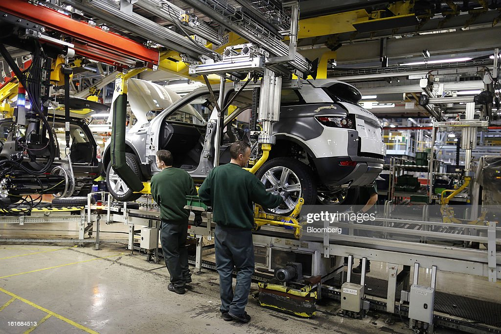 Employees work on a Range Rover Evoque SUV automobile, produced by Jaguar Land Rover Plc, a unit of Tata Motors Ltd., as it travels along the production line at the company's assembly plant in Halewood, U.K., on Wednesday, Feb. 13, 2013. Carmakers from Ford Motor Co. to Audi AG and Jaguar Land Rover Plc are using record amounts of aluminium to replace heavier steel, providing relief to producers of the metal confronting excess supplies and depressed prices. Photographer: Simon Dawson/Bloomberg via Getty Images