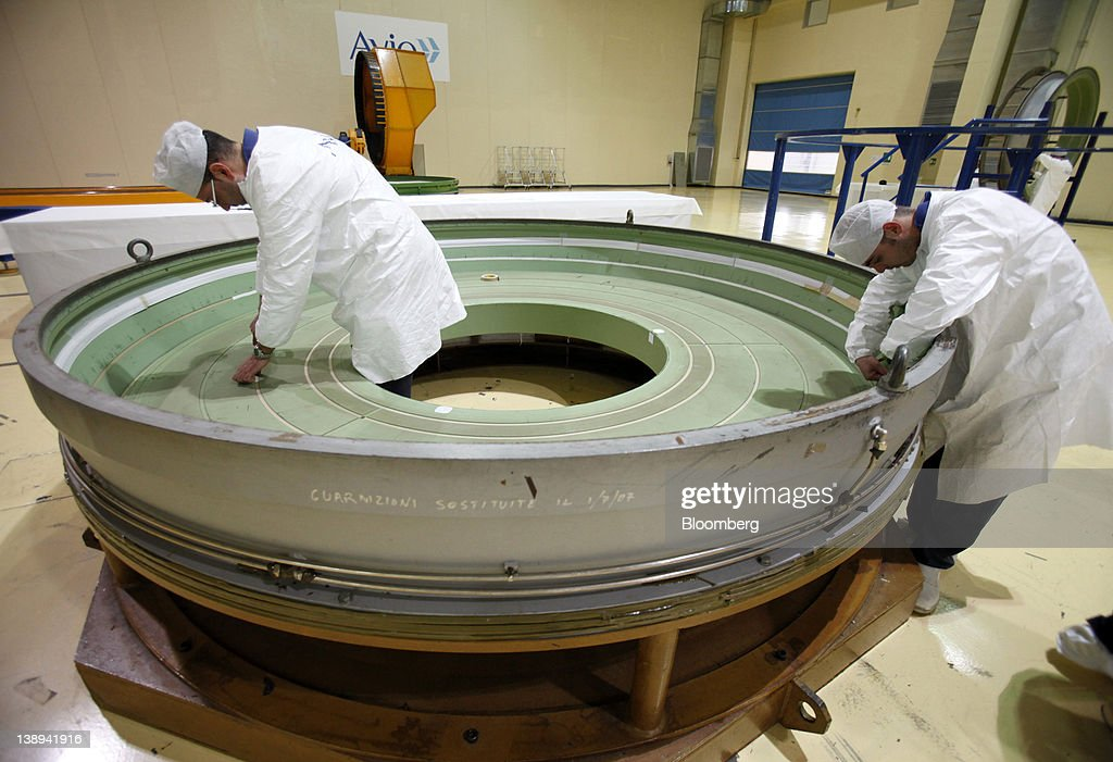 Employees work on a segment of an Avio SpA Ariane 5 space rocket booster at the company's production plant in Colleferro, near Rome, Italy, on Monday, Feb. 13, 2012. Avio, an Italian provider of aerospace services and equipment including gearboxes for aircraft engines, aims to sell shares to the public when the market improves, Chief Executive Officer Francesco Caio said in an interview. Photographer: Alessia Pierdomenico/Bloomberg via Getty Images