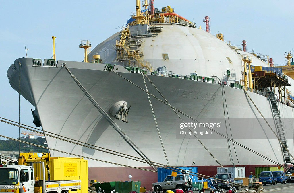Employees work on a ship under construction at the dock of Hyundai Heavy Industries (HHI) June 11, 2005 in Ulsan, South Korea. Hyundai Heavy Industries Co., one of the world's largest shipbuilders is leading the global shipbuilding industry, taking up about 15% share of the shipbuilding market. The shipbuilding division is capable of building all types of ships to meet various demands from its clients as it has nine large-scale dry docks with six huge 'Goliath Cranes.' Since the groundbreaking in 1972, HHI's Shipbuilding Division has continued to set new records in the shipbuilding industry over the past 30 years.
