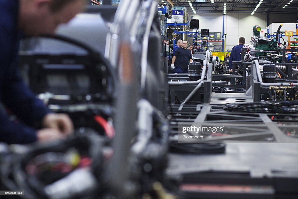 Employees work on bus chassis during assembly on the production line at Volvo AB's bus manufacturing plant in Wroclaw, Poland, on Friday, Jan. 11, 2013. Volvo plans to end bus making in Saeffle by June 2013, and will consolidate the business in Europe to its main plant in Wroclaw, Poland, the Gothenburg, Sweden-based company said. Photographer: Bartek Sadowski/Bloomberg via Getty Images