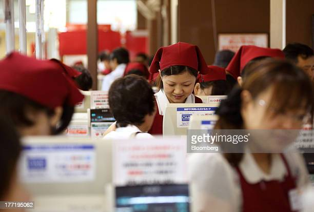 Employees work on check out counters at a Daiei Inc supermarket during a sale jointly held with Aeon Co at a Daiei supermarket in Urayasu City Chiba...