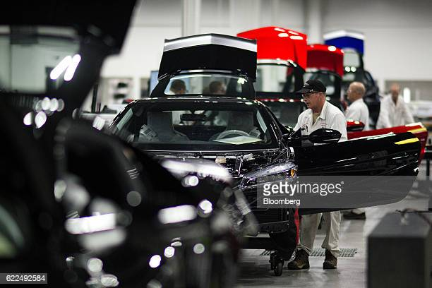 Employees work on Honda Motor Co 2017 Acura NSX vehicles during production at the Honda Performance Manufacturing Center in Marysville Ohio US on...