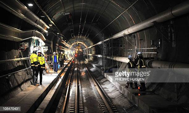 Employees work on January 28 2009 in the rail tunnel under the Channel linking Britain and France in Coquelles northern France to finish repairing...