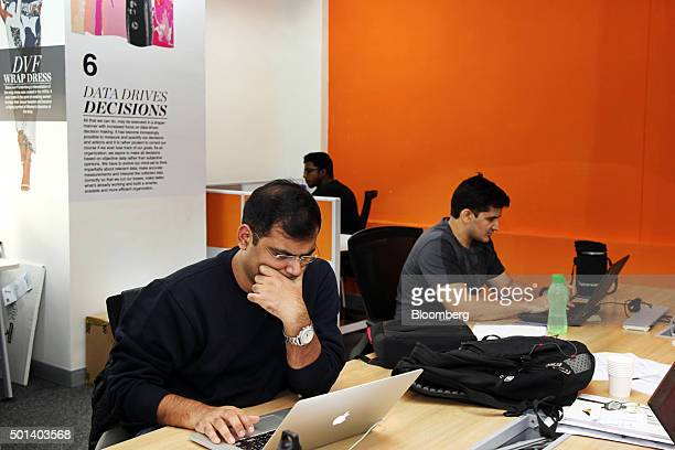 Employees work on laptop computers in the office of Myntracom a unit of Flipkart Internet Services Pvt in Bangaluru India on Friday Dec 04 2015...