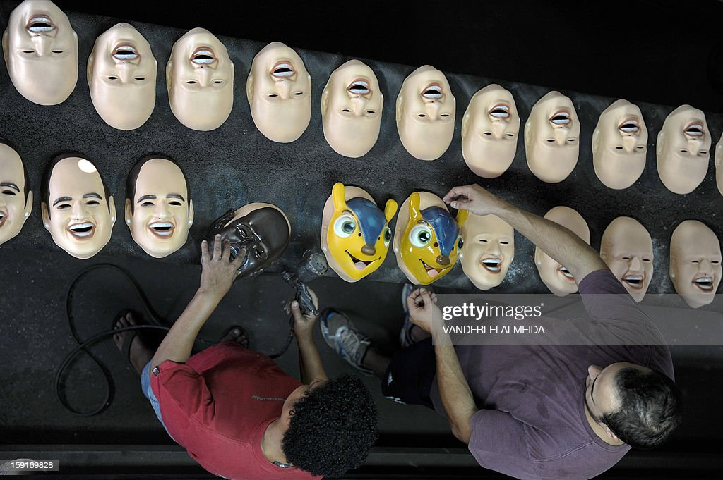 Employees work on masks of Brazilian football star Neymar, the president of the Brazilian Supreme Court Joaquim Barbosa and the mascot of the Brazil 2014 FIFA World Cup, 'Tatu Bola-Fuleco', at the carnival masks factory Condal, in Sao Gonçalo, about 35 km from downtown Rio de Janeiro, on January 9, 2013. Rio's world famous carnival takes place February 9-12.