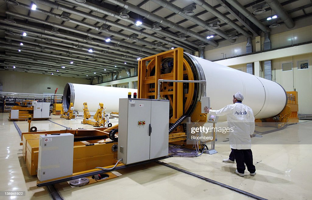 Employees work on segments of Avio SpA Ariane 5 space rocket boosters at the company's production plant in Colleferro, near Rome, Italy, on Monday, Feb. 13, 2012. Avio, an Italian provider of aerospace services and equipment including gearboxes for aircraft engines, aims to sell shares to the public when the market improves, Chief Executive Officer Francesco Caio said in an interview. Photographer: Alessia Pierdomenico/Bloomberg via Getty Images