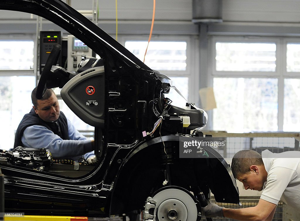 Employees work on the assembly line of the Smart ForTwo car at the Smart factory of Hambach, eastern France, on December 11, 2012. The third-generation Smart electric drive is scheduled to be launched in the U.S. and Europe by the second quarter of 2013 and Smart plans to mass produce the electric car with availability in 30 markets worldwide. VERHAEGEN