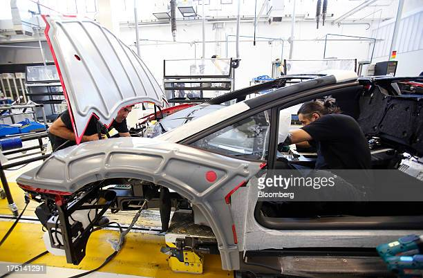 Employees work on the assembly of an Aventador automobile on the production line at the Lamborghini SpA factory in Sant'Agata Bolognese near Bologna...