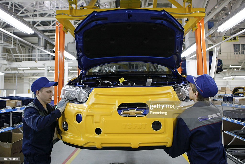 Employees work on the assembly of the front section of a Chevrolet Aveo automobile, a division of General Motors Co. (GM), on the production line at the GAZ Group plant in Niznhy Novgorod, Russia, on Tuesday, Feb. 5, 2013. GAZ, which is controlled by Russian billionaire Oleg Deripaska, plans to make 30,000 Aveo sedans and hatchbacks a year at its plant in Nizhny Novgorod starting in mid-2012. Photographer: Alexander Zemlianichenko Jr./Bloomberg via Getty Images