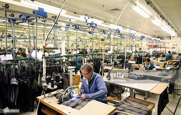 Employees work on the Barbour jacket production line at J Barbour Sons Ltd in South Shields UK on Tuesday Nov 6 2012 While the UK emerged from...