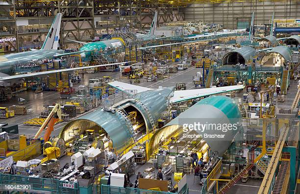 Employees work on the Boeing 777 assembly line June 13 2012 at the Boeing Factory in Everett Washington