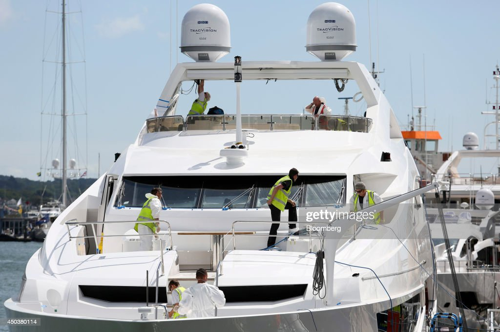 Employees work on the deck of a 40 meter Sunseeker yacht produced by Sunseeker International Ltd a unit of China's Dalian Wanda Group during assembly...