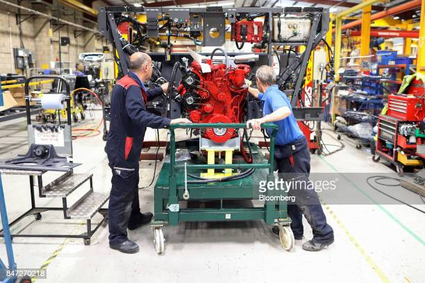 Employees work on the engine section of an Enviro 200 bus at the Alexander Dennis Ltd factory in Guildford UK on Monday Sept 11 2017 Manufacturing in...
