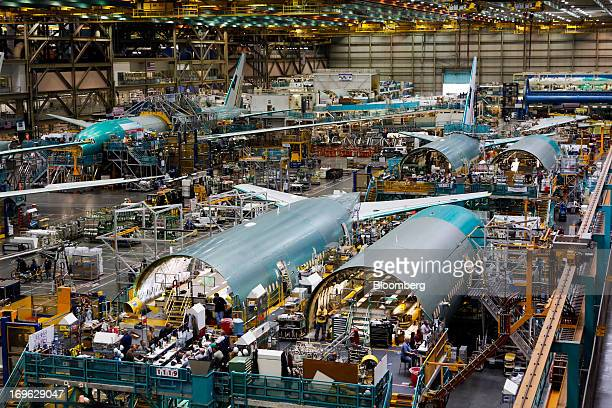 Employees work on the final assembly line of a Boeing Co 777 airplane at the Boeing Co factory in Everett Washington US on Tuesday May 28 2013 Boeing...