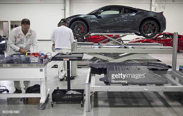 Employees work on the final assembly stage of the Honda Motor Co 2017 Acura NSX vehicle at the Honda Performance Manufacturing Center in Marysville...