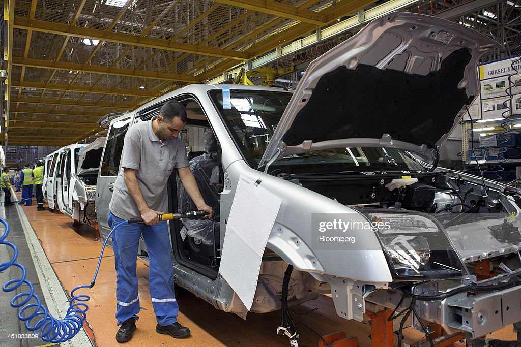 Employees work on the Ford Connect van production line at the Ford Otosan plant, the joint venture between Ford Motor Co.'s Ford Otomotiv Sanayi AS and Koc Holding AS, in Golcuk, Turkey, on Wednesday, Nov. 20, 2013. Istanbul-based Automobile Distributors' Association, or ODD, forecasts Turkey's total automotive industry market to be between 830k and 870k this year. Photographer: Kerem Uzel/Bloomberg via Getty Images