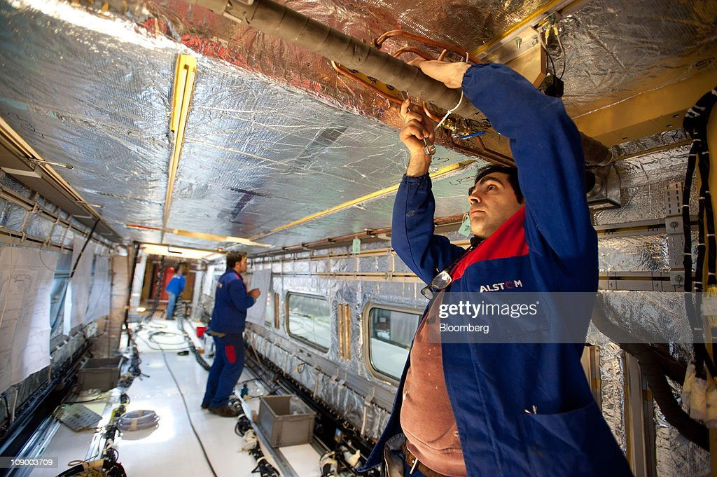 Employees work on the interior assembly of a highspeed Pendolino train at Alstom SA's trainbuilding unit in Savigliano Italy on Friday Feb11 2011...