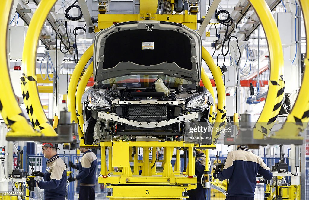 Employees work on the Maserati Quattroporte luxury automobile production line at Fiat SpA's Grugliasco factory in Turin, Italy, on Wednesday, Jan. 30, 2013. Fiat SpA Chief Executive Officer Sergio Marchionne said the Italian carmaker narrowed losses in Europe in the fourth quarter, helping it achieve full-year earnings that were in line with its forecasts. Photographer: Alessia Pierdomenico/Bloomberg via Getty Images