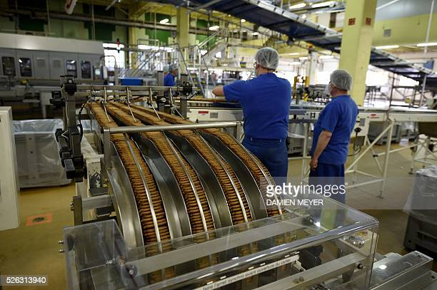 Employees work on the production line of the 'petit beurre' biscuit in the factory of French biscuit manufacturer LU in La HayeFouassiere near Nantes...