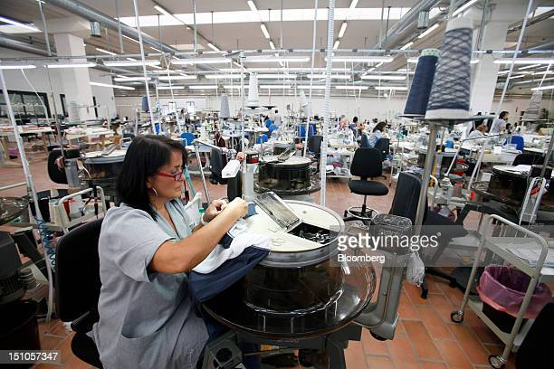 Employees work on the sewing floor of the Brunello Cucinelli SpA production facility in Solomeo near Perugia Italy on Thursday Aug 30 2012 Cucinelli...