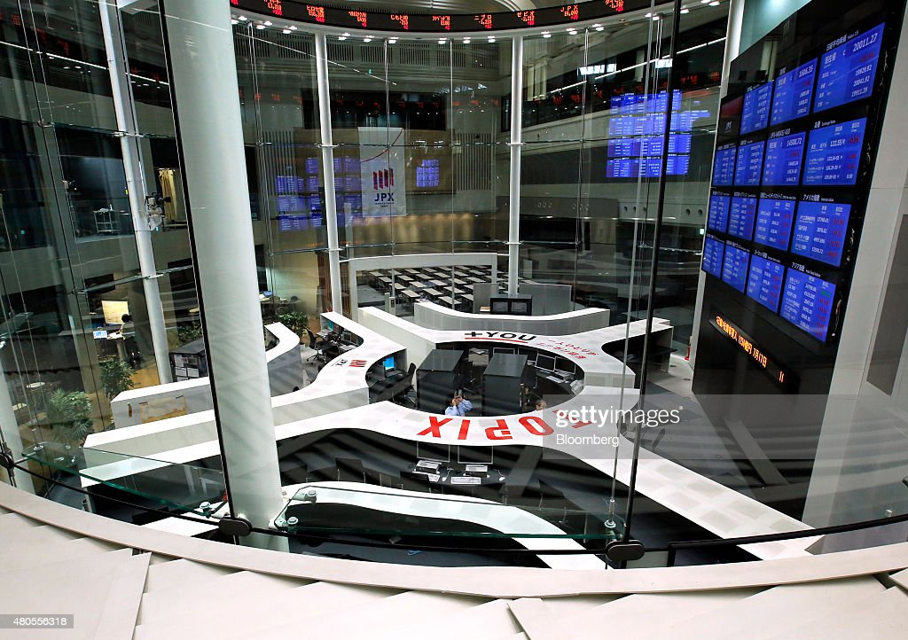 Employees work on the trading floor of the Tokyo Stock Exchange operated by Japan Exchange Group Inc in Tokyo Japan on Monday July 13 2015 Japanese...