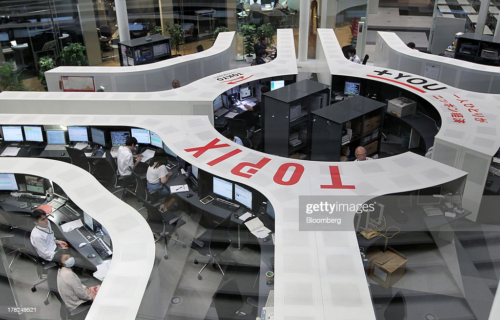 Employees work on the trading floor of the Tokyo Stock Exchange in Tokyo Japan on Wednesday Aug 28 2013 Japanese shares declined with the Topix index...