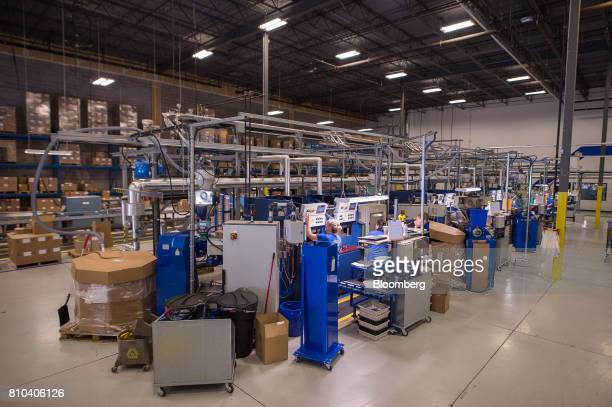 Employees work on the vinyl record manufacturing line at the Precision Record Pressing facility in Burlington Ontario Canada on Friday June 30 2017...