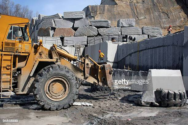 Employees work with large blocks of granite at a Rock of Ages Corp quarry in Graniteville Vermont US on Tuesday April 22 2008 Rock of Ages Corp...