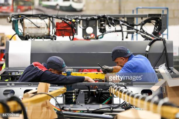 Employees work within the chassis of an Enviro 200 bus at the Alexander Dennis Ltd factory in Guildford UK on Monday Sept 11 2017 Manufacturing in...