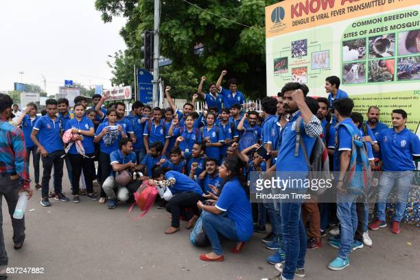 Employees working at AIIMS hired by a third party vendor TCS as patient sahayaks for a project protest outside the hospital against termination of...