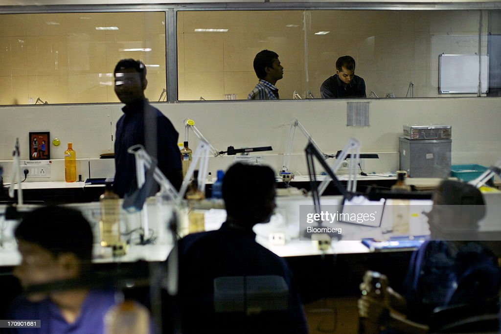 Employees working on the production line of the Kama Schachter Jewelry Pvt Ltd. diamond studded gold and platinum manufacturing facility in Mumbai, India, on Wednesday, June 19, 2013. India's exports of diamonds and gold jewelry grew 5.2% to $6.1 billion in April and May, says the Gem & Jewellery Export Promotion Council on June 18, 2013. Photographer: Adeel Halim/Bloomberg via Getty Images