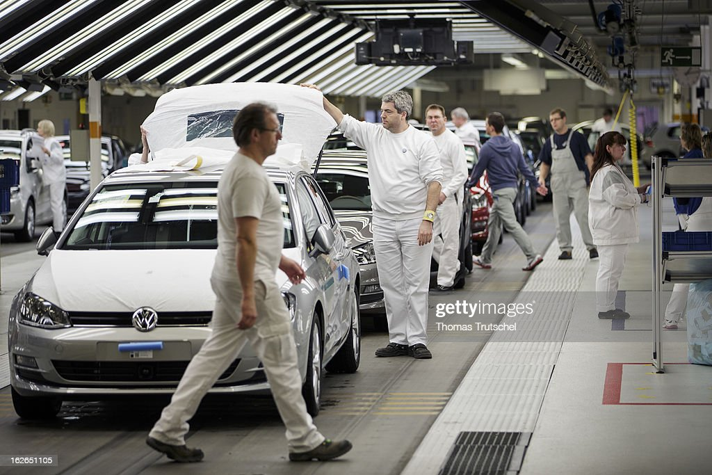 Employees works on the assembly line producing bonnets for new Volkswagen Golf 7 cars at the Volkswagen factory on February 25, 2013 in Wolfsburg, Germany. Volkswagen Aktiengesellschaft announced its key financial data for fiscal year 2012 with sales revenue of EUR 192.7 billion, against the prior year of EUR 159.3 billion. The Group's operating profit of EUR 11.5 billion exceeded the prior-years record level.