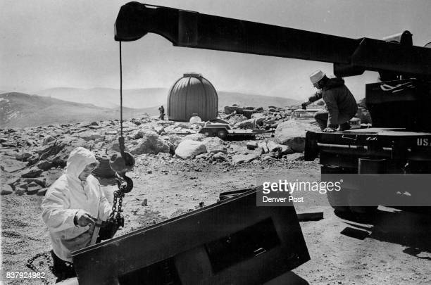 Employes Of University Of Denver's High Altitude Laboratory Try To Reload Generator That Toppled Off Trailer A 24inch Ealing telescope being built at...