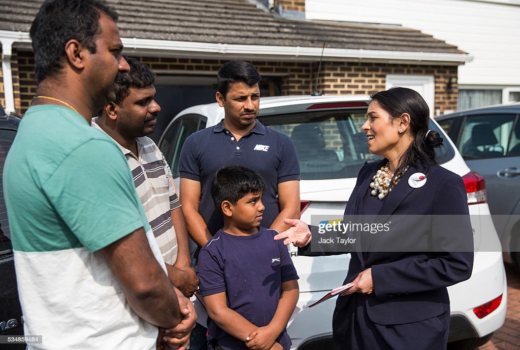 Employment Secretary <a gi-track='captionPersonalityLinkClicked' href=/galleries/search?phrase=Priti+Patel&family=editorial&specificpeople=7114708 ng-click='$event.stopPropagation()'>Priti Patel</a> (R) speaks with local residents while out canvassing on behalf of Vote Leave on May 28, 2016 in Maidstone, England. Former Work and Pensions Secretary Iain Duncan Smith and Employment Secretary <a gi-track='captionPersonalityLinkClicked' href=/galleries/search?phrase=Priti+Patel&family=editorial&specificpeople=7114708 ng-click='$event.stopPropagation()'>Priti Patel</a> are in Kent today campaigning for a vote to leave the European Union, ahead of the EU referendum on June 23rd.
