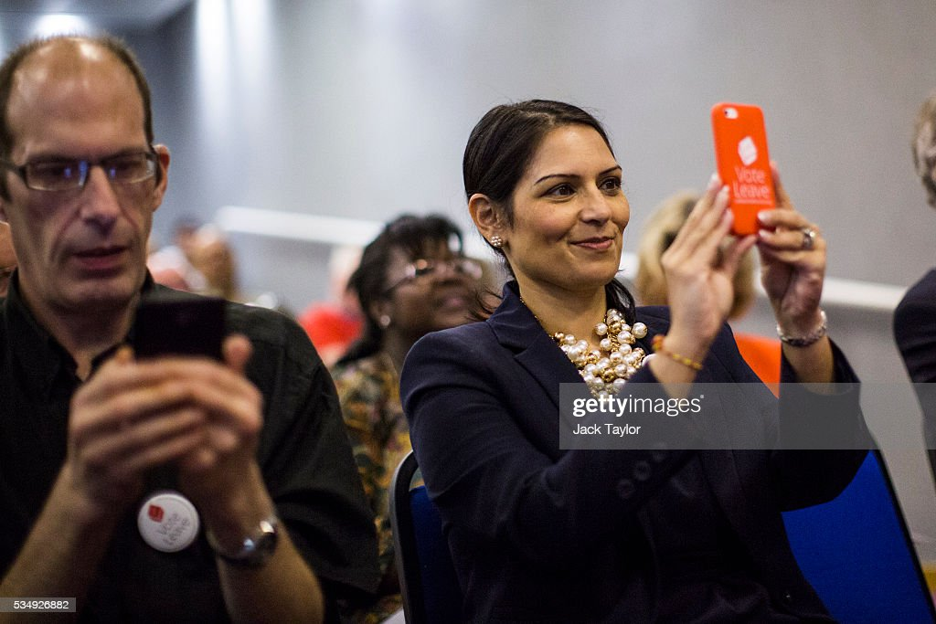 Employment Secretary <a gi-track='captionPersonalityLinkClicked' href=/galleries/search?phrase=Priti+Patel&family=editorial&specificpeople=7114708 ng-click='$event.stopPropagation()'>Priti Patel</a> (R) takes a picture as former Work and Pensions Secretary Iain Duncan Smith delivers a speech at Kent County Council on May 28, 2016 in Maidstone, England. Prominent members of the Conservative Party are campaigning on behalf of Vote Leave in Kent today, ahead of the EU referendum on June 23rd.