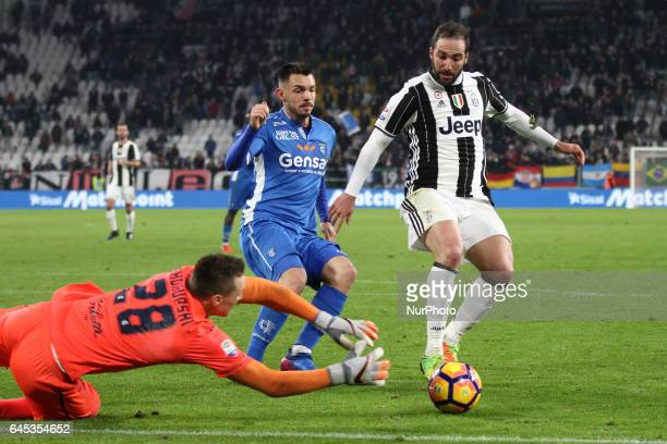 Empoli goalkeeper Lukasz Skorupski dives for the ball against Juventus forward Gonzalo Higuain during the Serie A football match n26 JUVENTUS EMPOLI...