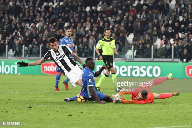 Empoli goalkeeper Lukasz Skorupski dives for the ball during the Serie A football match n26 JUVENTUS EMPOLI on at the Juventus Stadium in Turin Italy