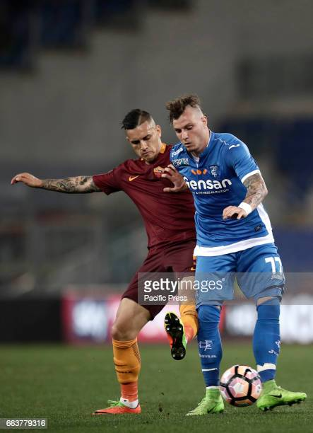 Empoli Marcel Buchel right is challenged by Roma Leandro Paredes during the Serie A soccer match between Roma and Empoli at the Olympic stadium Roma...