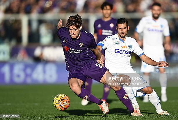 Empoli's defender from France Vincent Laurini vies with Fiorentina's defender from Spain Marcos Alonso Mendoza during the Italian Serie A football...