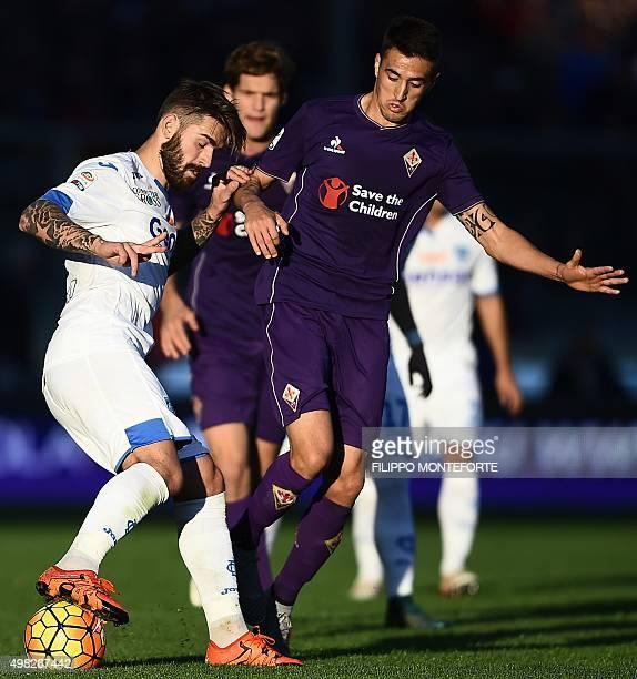 Empoli's forward from Croatia Marko Livaja vies with Fiorentina's forward from Uruguay Matias Vecino during the Italian Serie A football match...