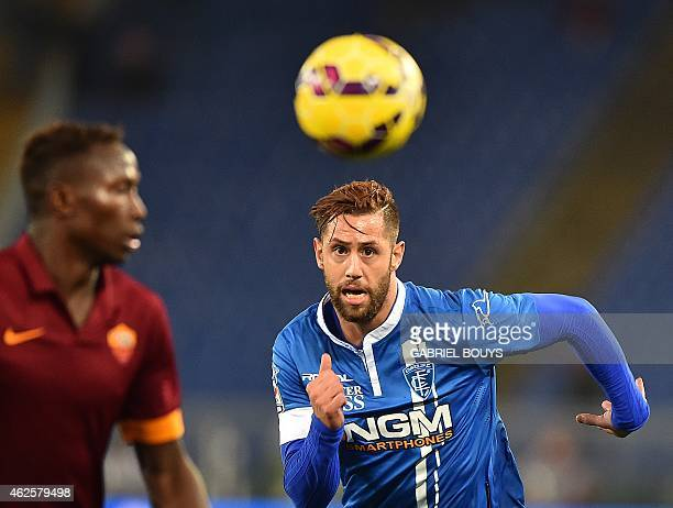 Empoli's forward from Georgia Levan Mchedlidze vies with Roma's defender from France Mapou YangaMbiwa during the Italian Serie A football match...