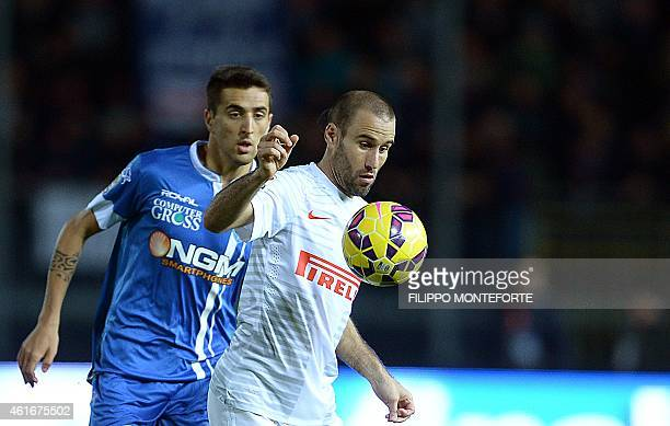 Empoli's forward from Uruguay Matias Vecino vies with Inter Milan's forward from Argentina Rodrigo Palacio during the Italian Serie A football match...