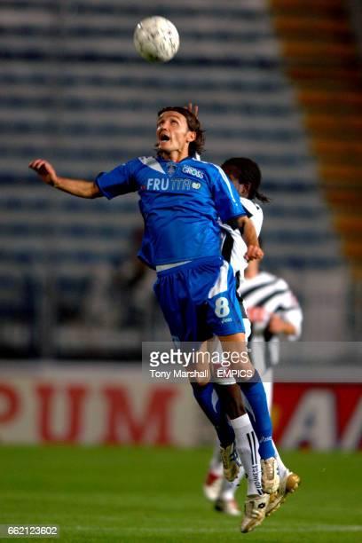Empoli's Francesco Marianini wins a header