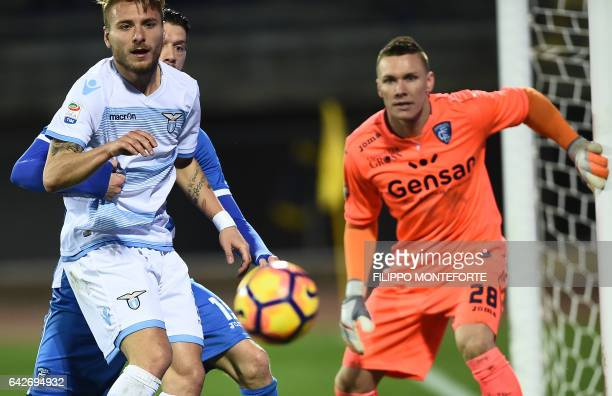 Empoli's goalkeeper from Poland Lukasz Skorupski and Lazio forward from Italy Ciro Immobile eye the ball during the italian Serie A football match...