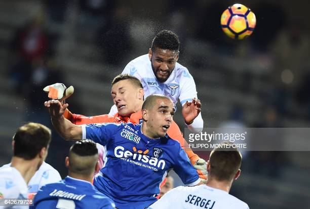Empoli's goalkeeper from Poland Lukasz Skorupski vies with Lazio's midfielder from Brazil Felipe Anderson during the Italian Serie A football match...