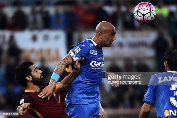 Empoli's Italian forward Massimo Maccarone vies with Roma's Egyptian midfielder Mohamed Salah during the Italian Serie A football match Roma vs...