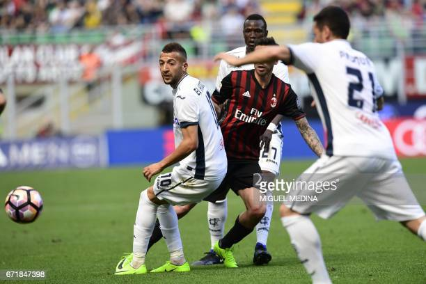 Empoli's Moroccan midfielder Omar El Kaddouri vies with AC Milan's Argentinian midfielder José Sosa during the Italian Serie A football match AC...